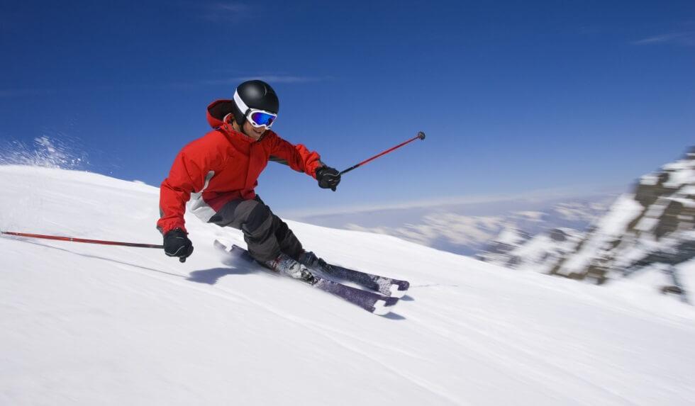 skier skiing downhill